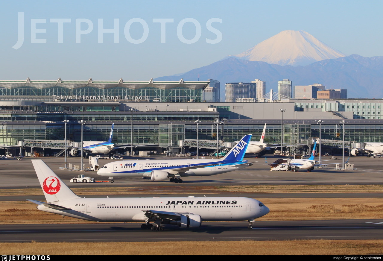 A Japan Airlines 767 and ANA 787 in Tokyo with Mt Fuji in the background
