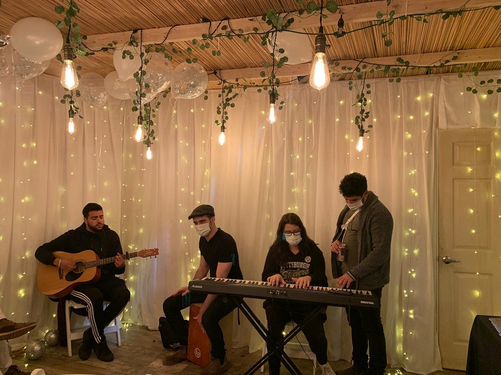 musicians playing in the sukkah