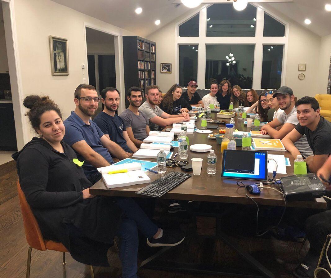 Sinai Scholars group sitting around a table
