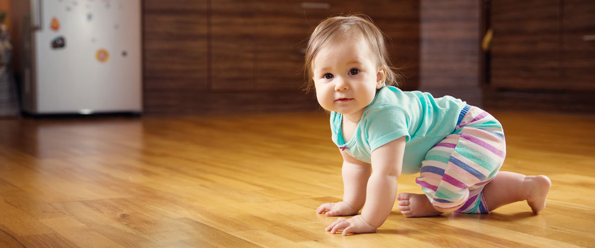 Baby crawling across the kitchen floor.