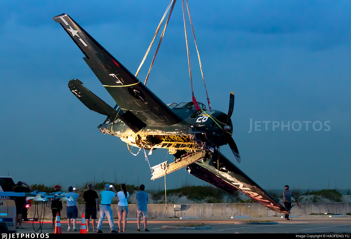 TBM Avenger being lifted off the beach by a crane