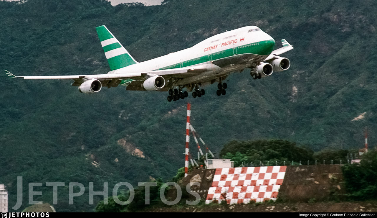 A Cathay Pacific 747 making the famous checkerboard turn to land at Kai Tak Airport in Hong Kong