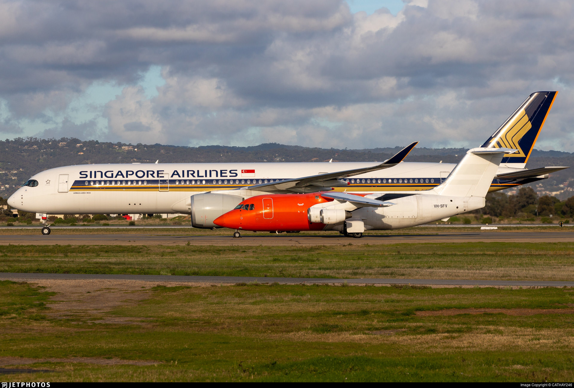 A Singapore Airlines A350 and Pionair BAe-146 side by side