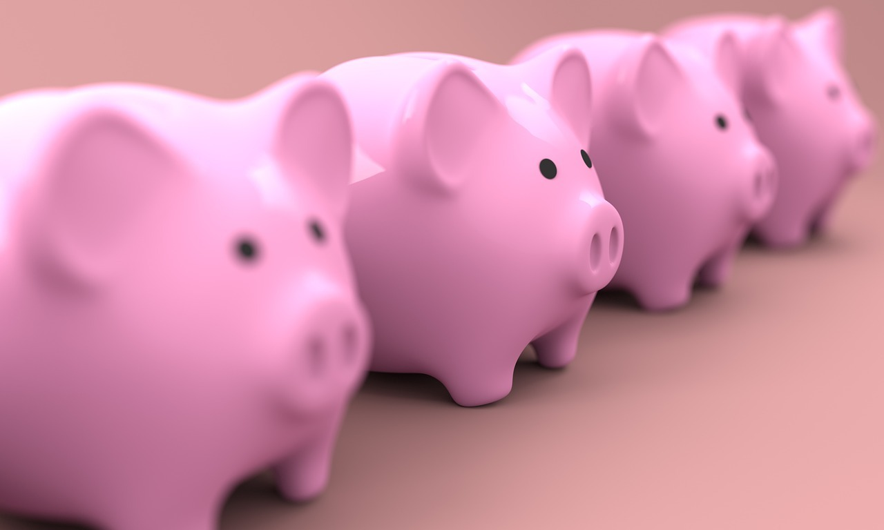 Line of piggy banks