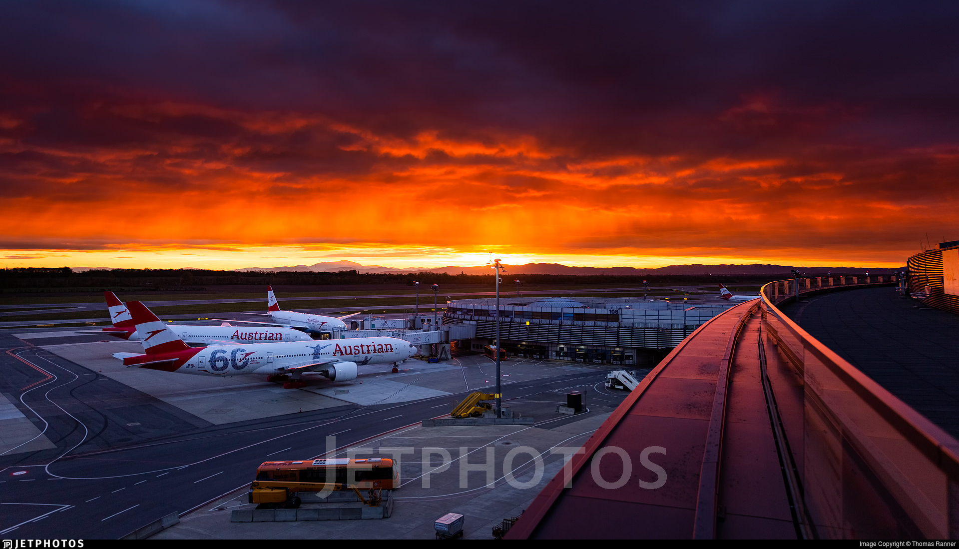 Sunset in Vienna with Austrian Airlines aircraft parked at the gate