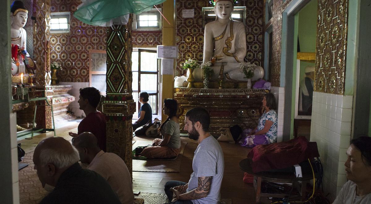 Pilgrims meditating in Burma