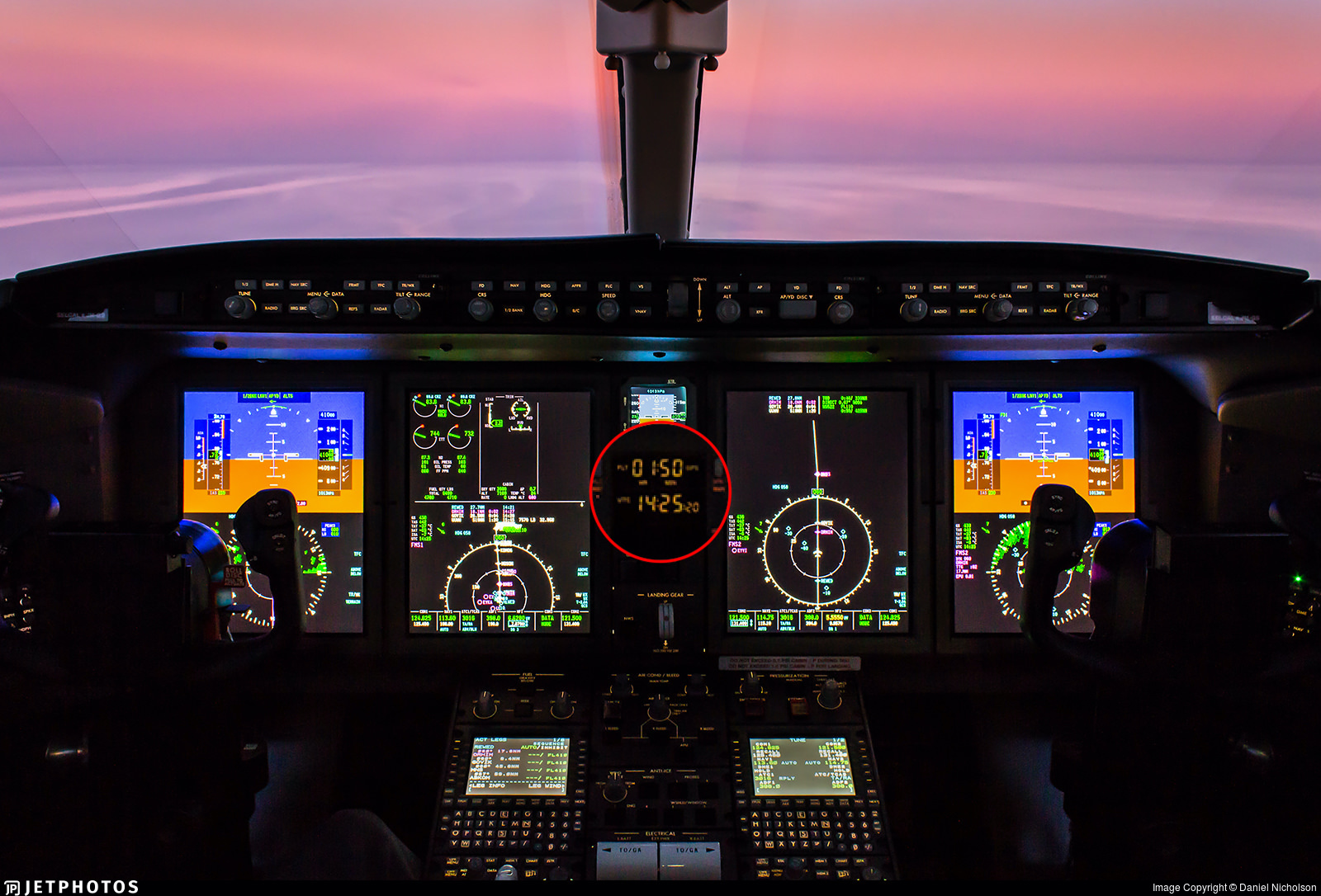 Bombardier Challenger flight deck with the UTC clock magnified for effect
