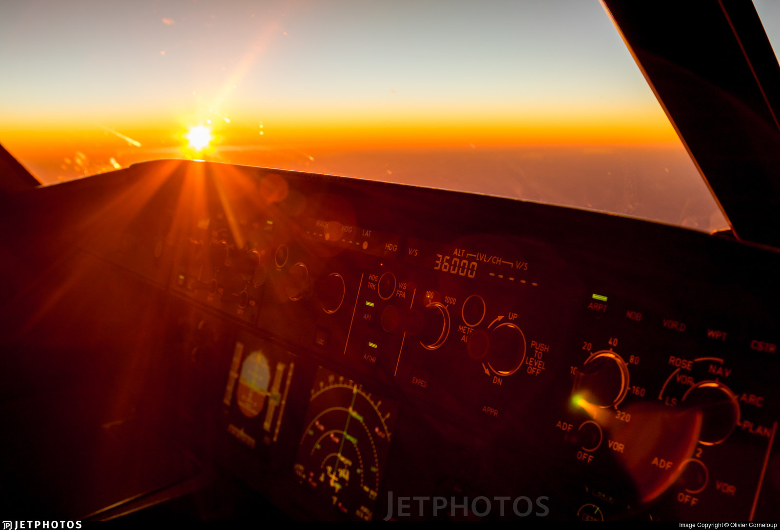 Viewing the sunset from the flight deck of an Aigle Azur A320