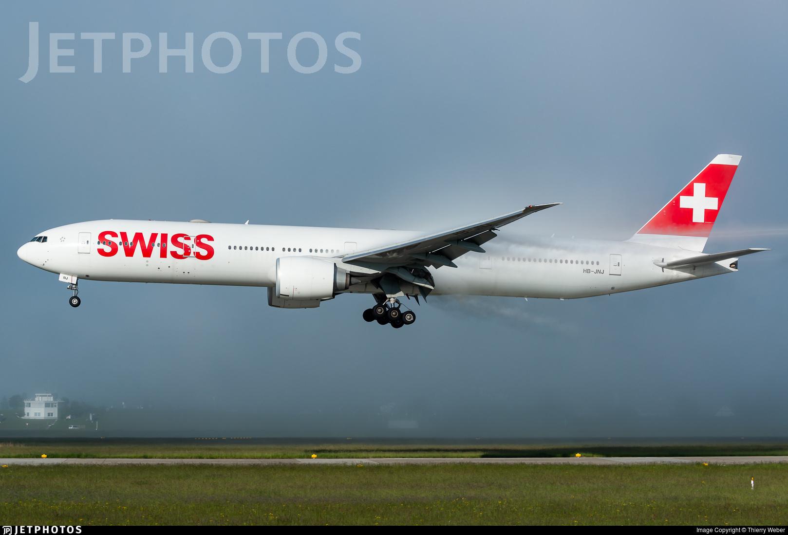 A Swiss 777 landing in Zurich through the fog