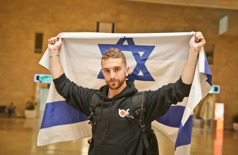 Simcha Brodsy holding Israel flag