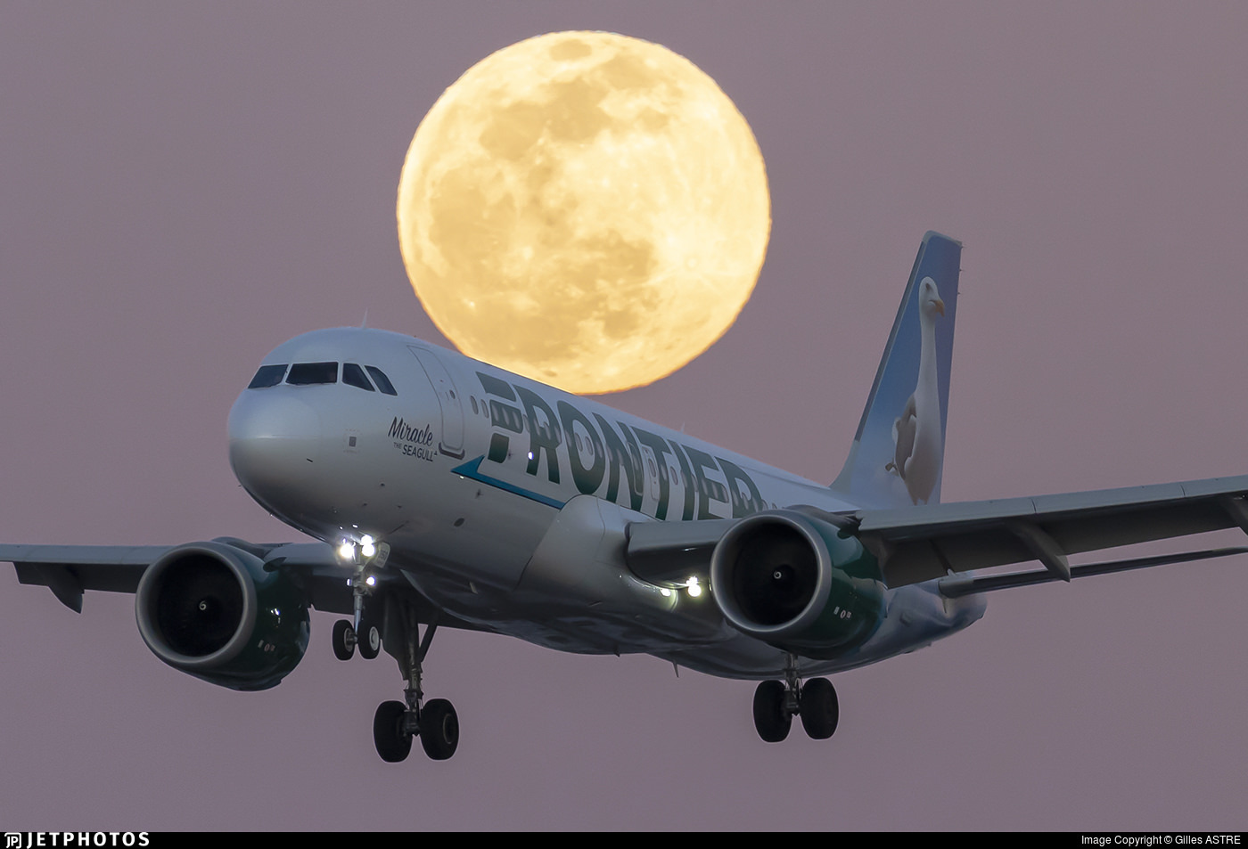 Frontier A320 and a full moon