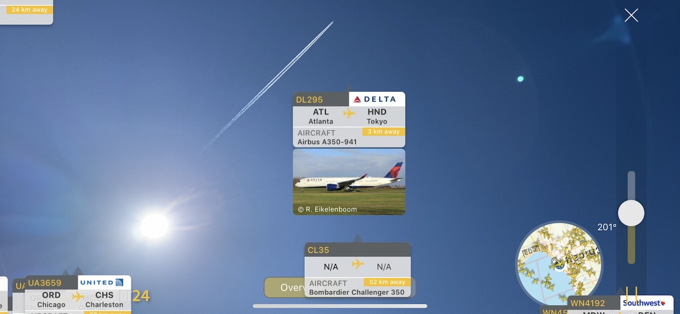 AR View example showing a Delta A350 high above Chicago leaving a contrail