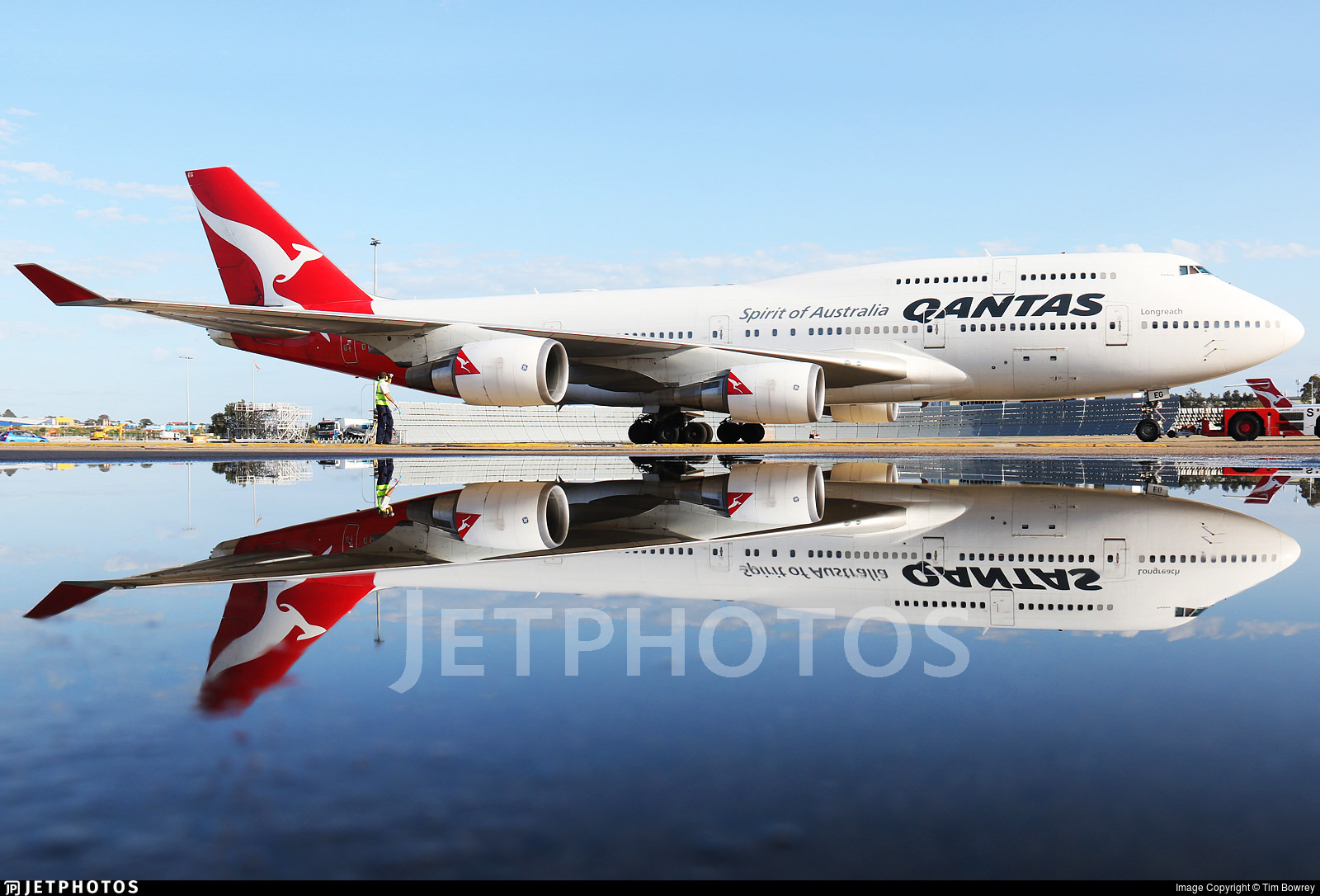 Qantas 747 reflecting in a puddle in Sydney