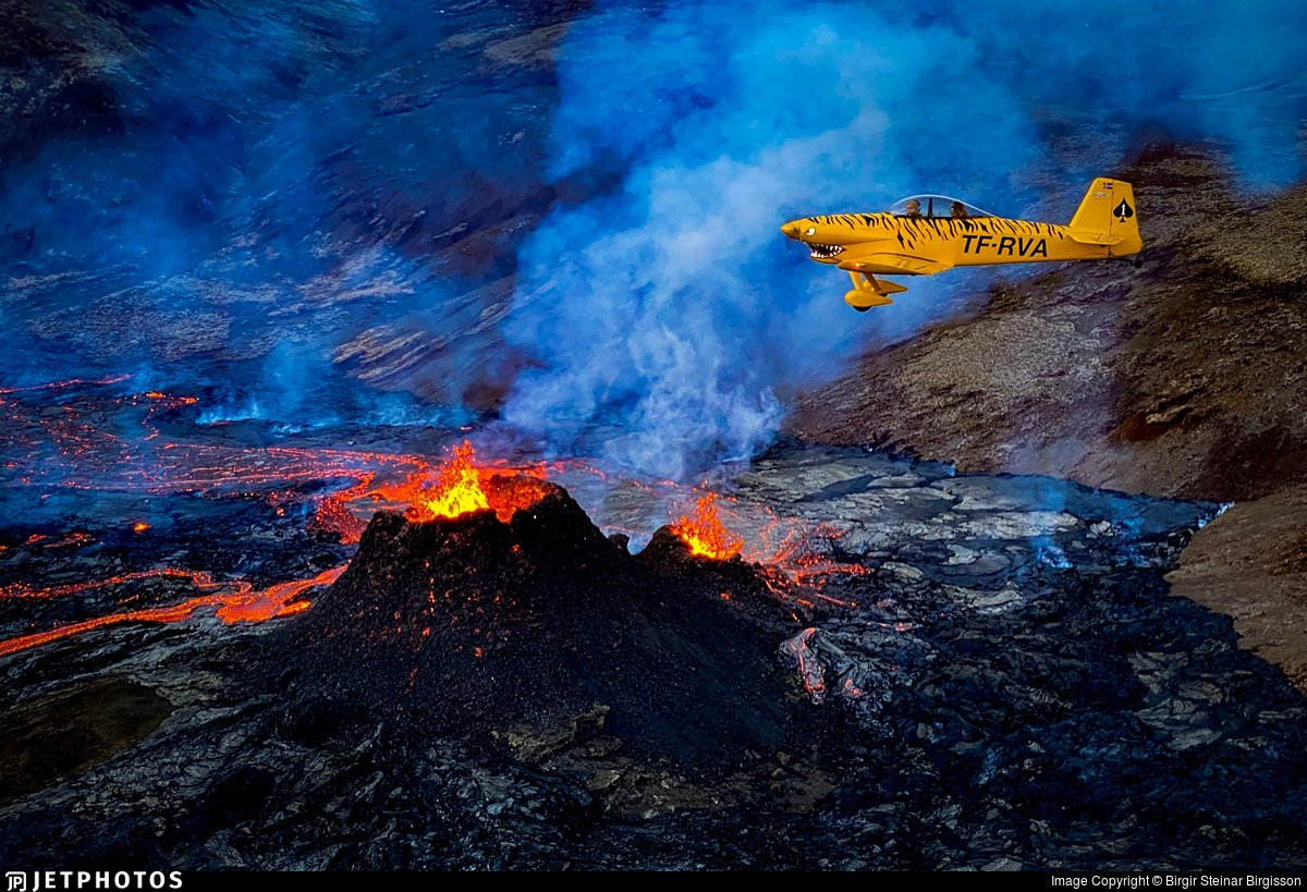 A Vans RV-4 aircraft registered TF-RVA takes the pilot and passenger over the erupting volcano at Fagradalsfjall