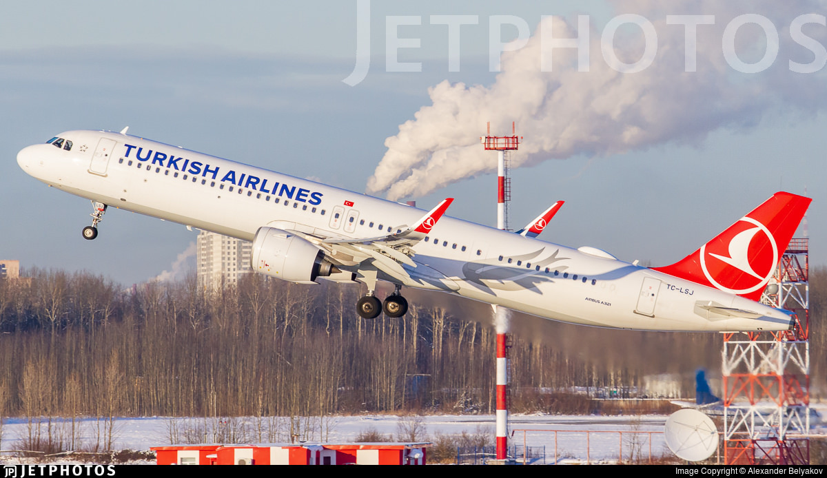 A Turkish Airlines A321neo departing St Petersburg. The photo captured at the moment the aircraft is directly in front of a building chimney, giving the impression that the aircraft has steam vents.