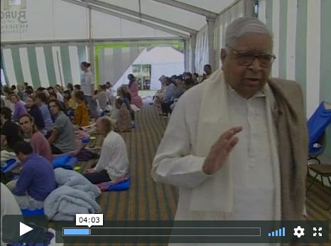 Screen grab 'Messenger of Dhamma' video, showing Vipassana teacher S.N. Goenka chanting and giving mettā