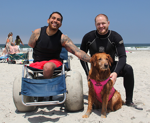 Therapy Dog Surfs With Triple-Amputee Veteran