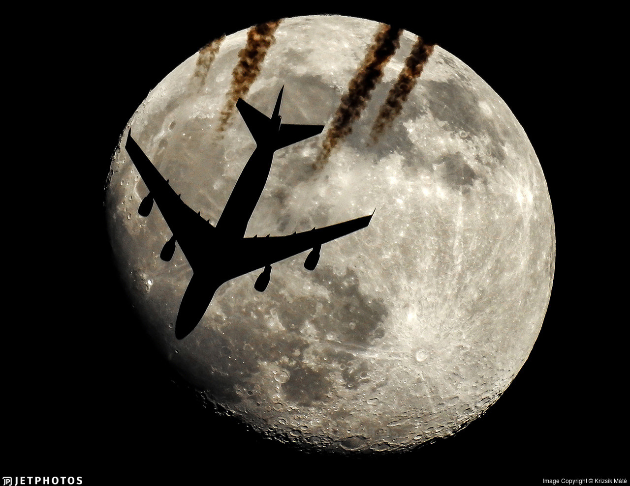 A China Airlines Cargo 747 passing in front of the moon