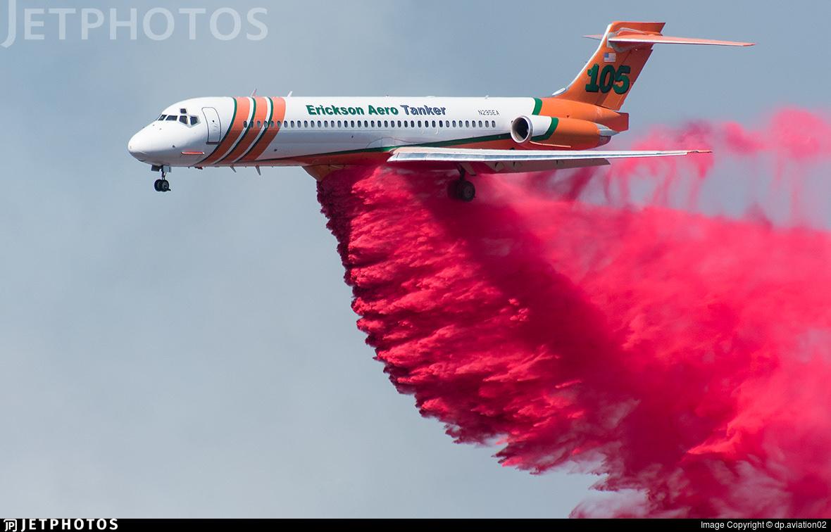 A Erickson Aero Tanker MD-87 making a fire retardant drop