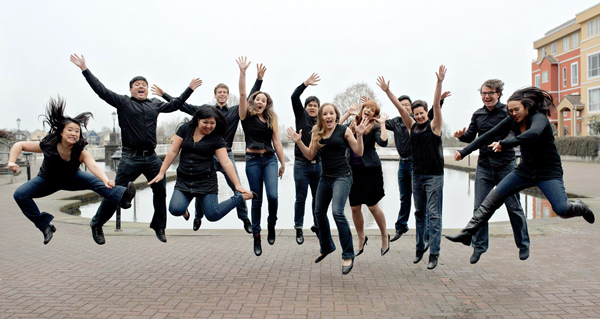 Group of people jumping with enthusiasm