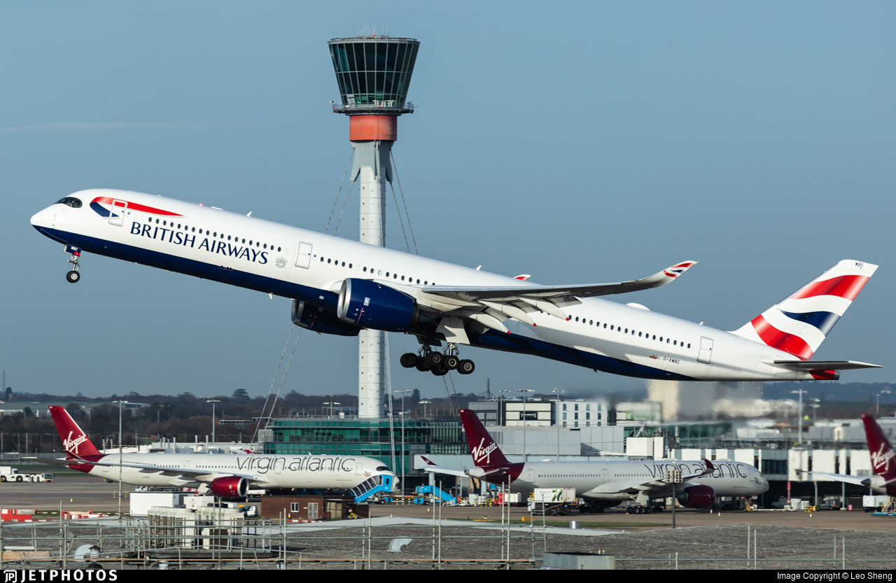 A British Airways A350 departing London's Heathrow Airport past the air traffic control tower