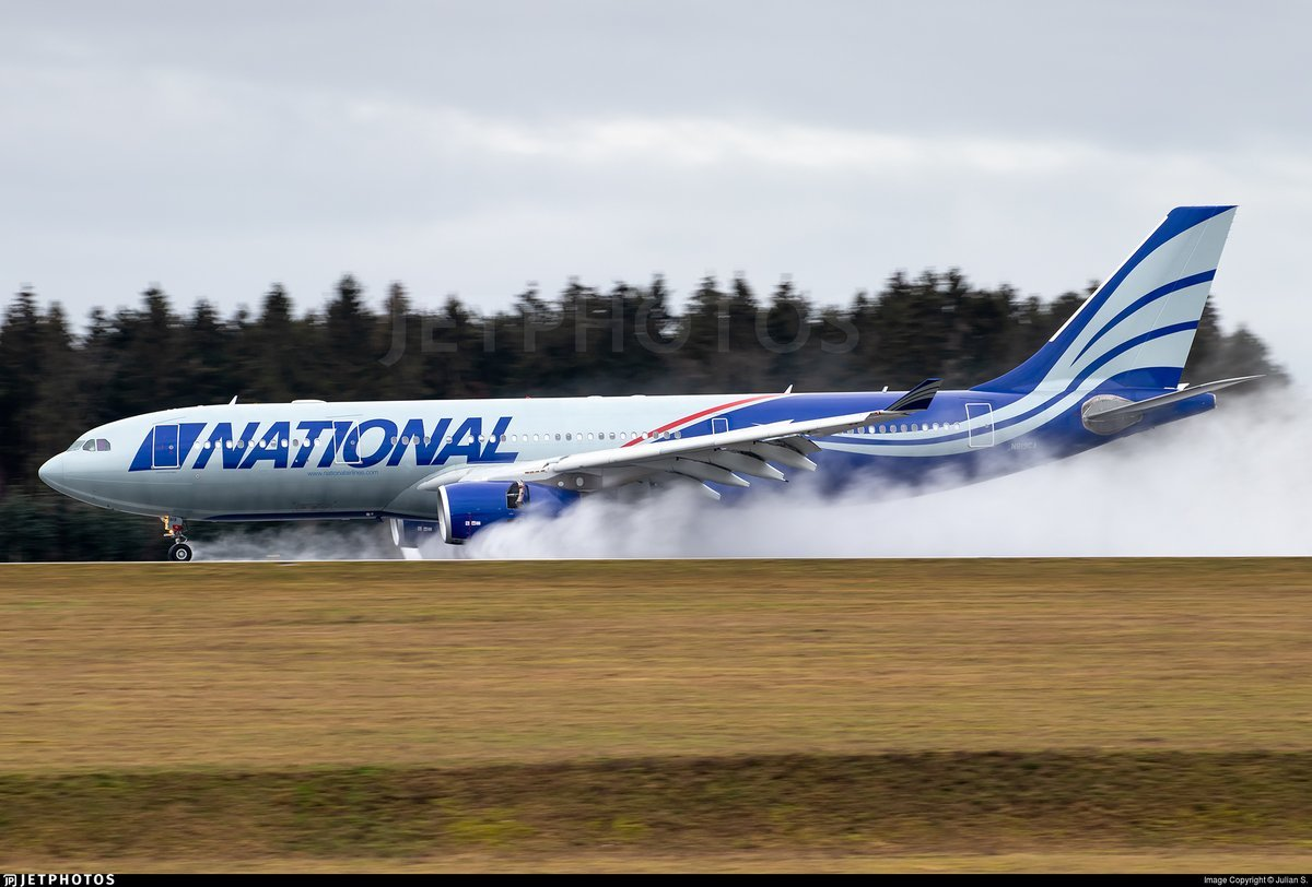 A National Airlines A330 under reverse thrust as it lands